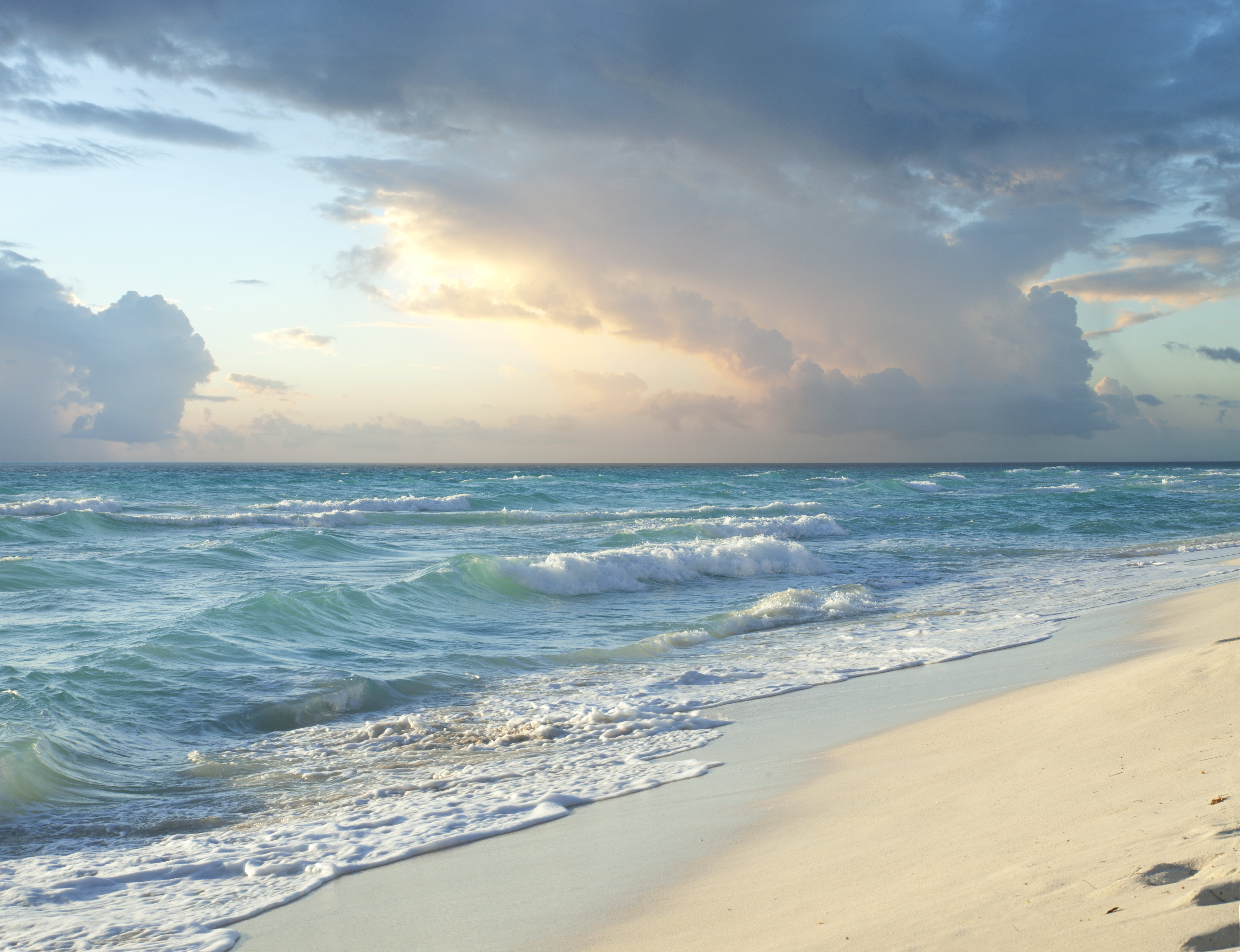 content/slider/tropical-beach-and-stormy-clouds.jpg